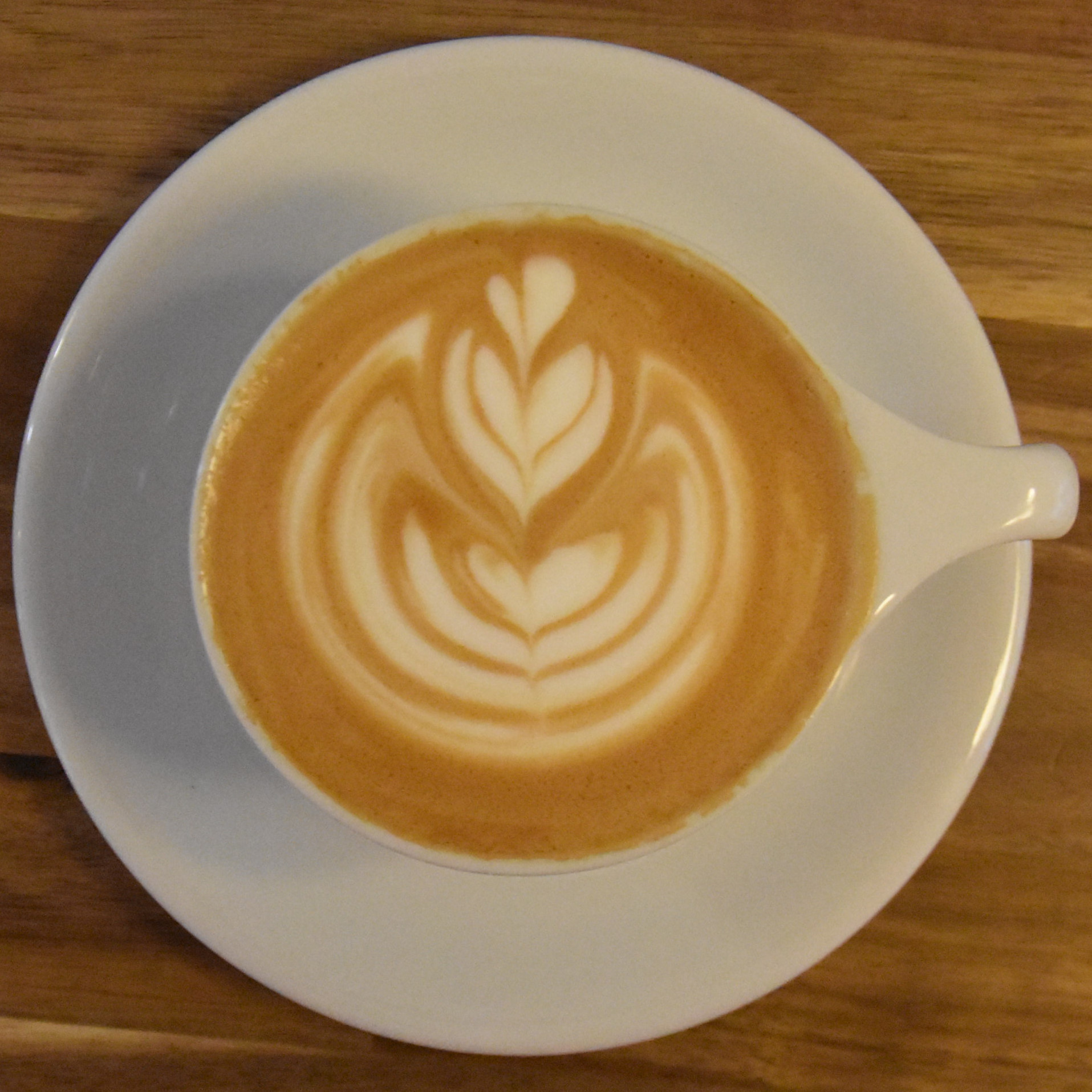 A beautiful flat white, with gorgeous latte art, at Scandinavian Embassy in Amsterdam, made with an espresso blend from Coffee Collective.