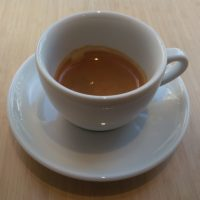 The single-origin Brazilian espresso from Red Bank Coffee served in an over-sized, classic white cup at Alex Coffee.