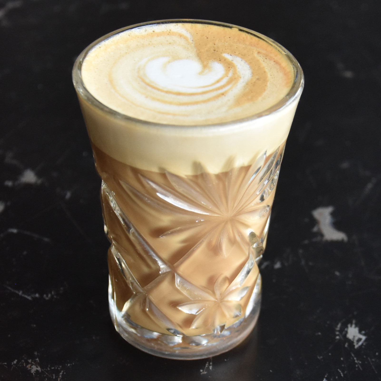 A cortado, made with a single-origin espresso, and served in a lovely glass at Cherry Coffee Roasters in New Orleans.
