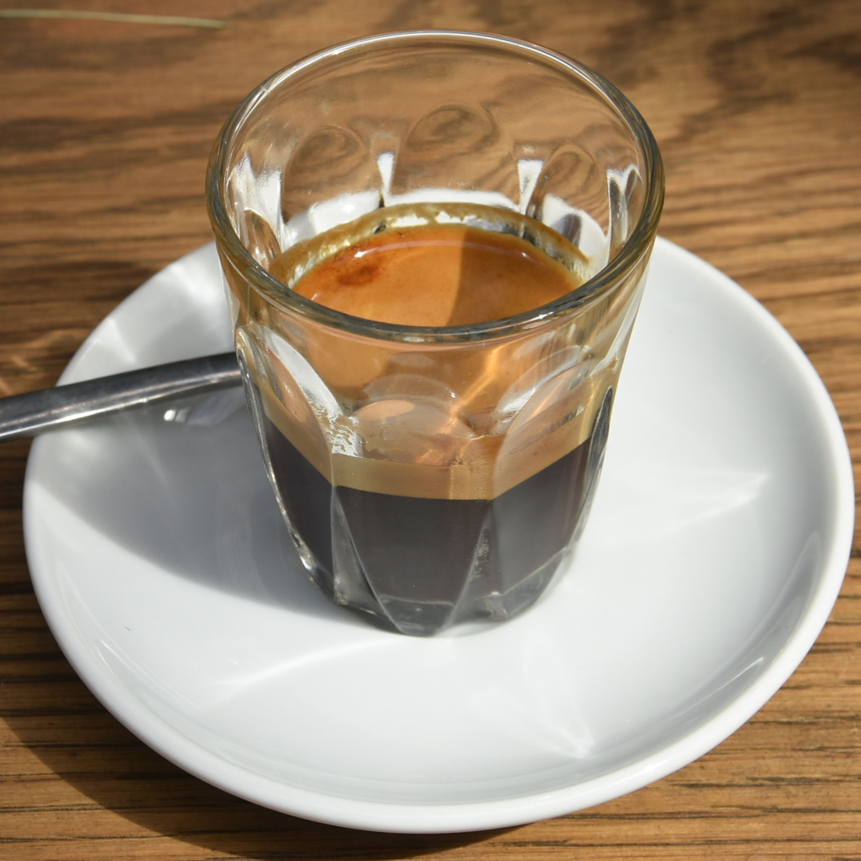 What's The Story?, a washed Ethiopian single-origin espresso from Wegida in Yirgacheffe, served in a glass at the Department of Coffee and Social Affairs Paddington Central branch.