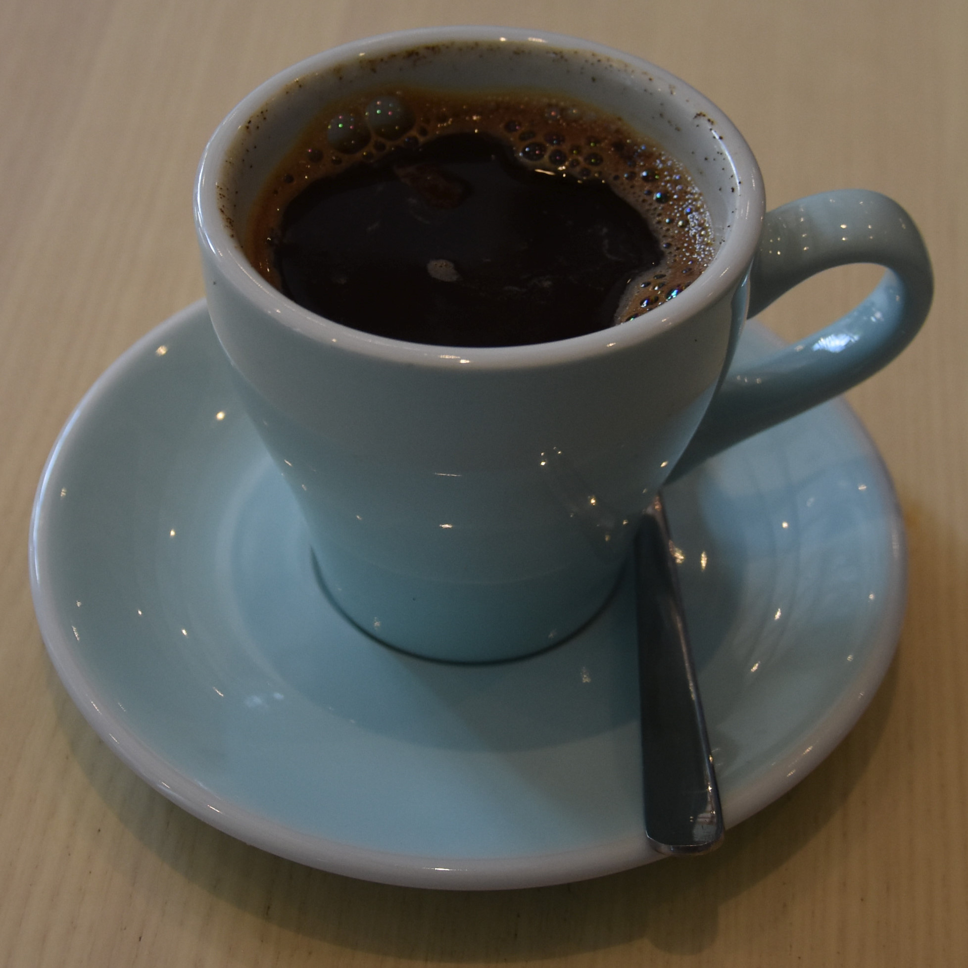 A Kopi Tubruk, a traditional Indonesian coffee, where hot water is poured directly on ground coffee, stirred and then left to stand, made with a naturally-processed Kerinci Kayu Aro from Ngopi in Birmingham.