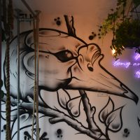 Part of the amazing mural on the wall of Long & Short Coffee in Walthamstow, showing a bird's head.