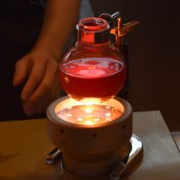 A syphon at Maruyama Coffee in Nagano Station, warming on the infrared heater after brewing.