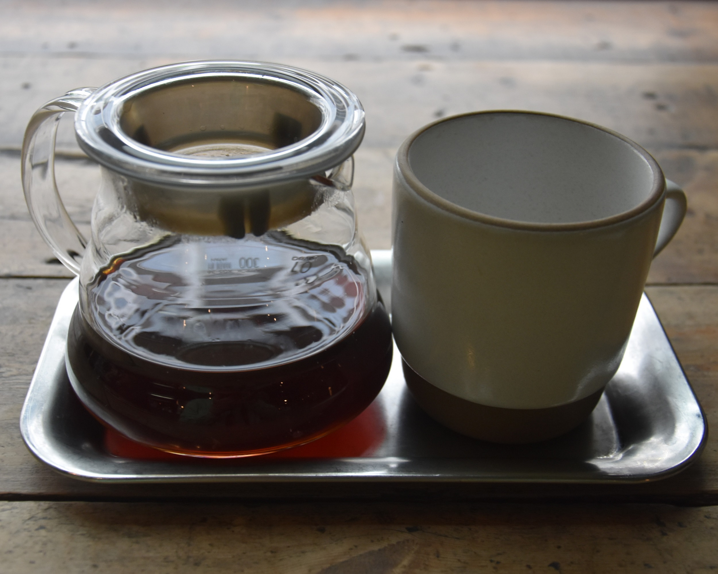A lovely Kenyan Githaka AB Estate V60, roasted and served at Ozone in Shoreditch, the coffee presented on a tray, with a short mug next to the carafe.