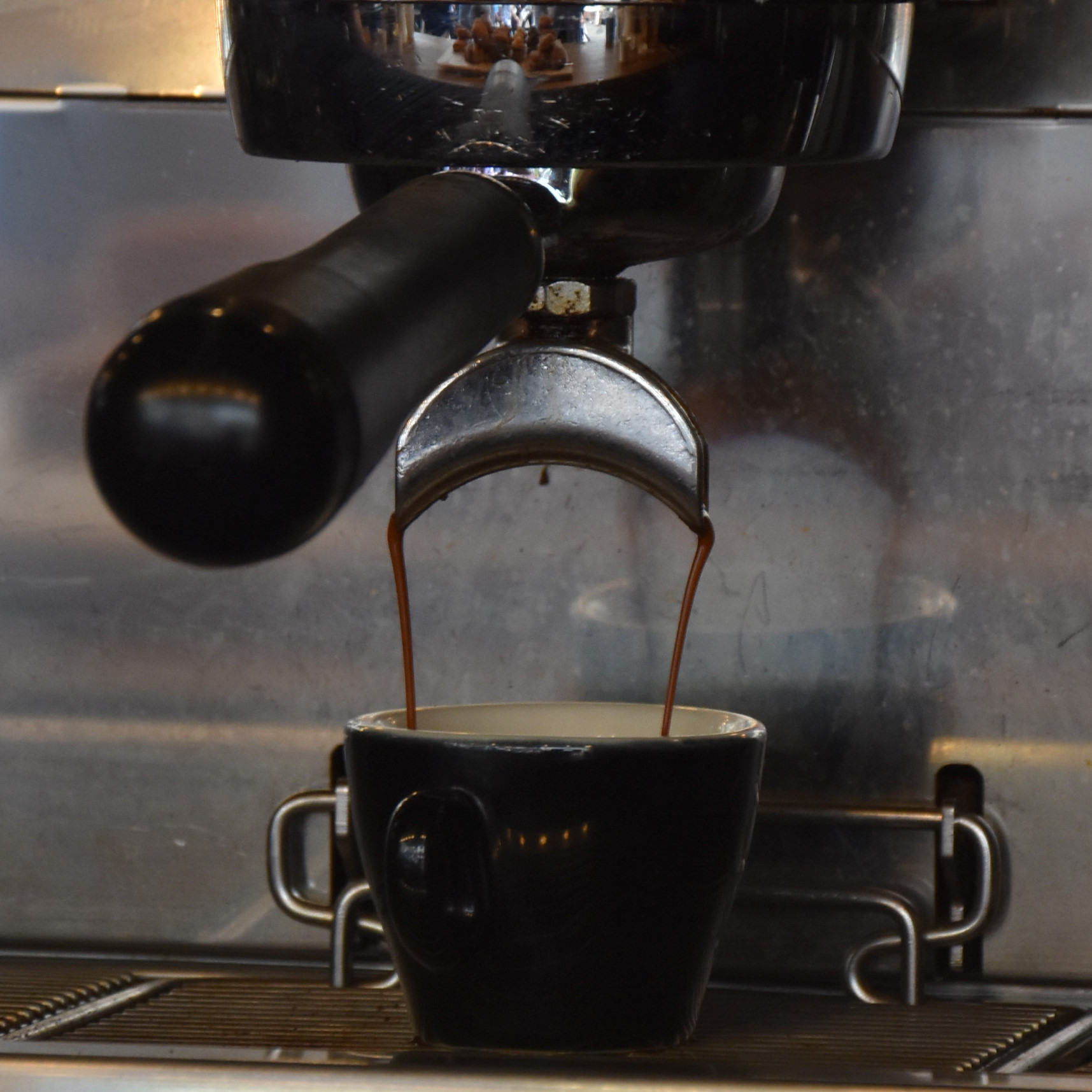 Watching espresso extract for a Victoria Arduino Black Eagle espresso machine in the Browns of Brockley mobile coffee van at Lord's cricket ground.