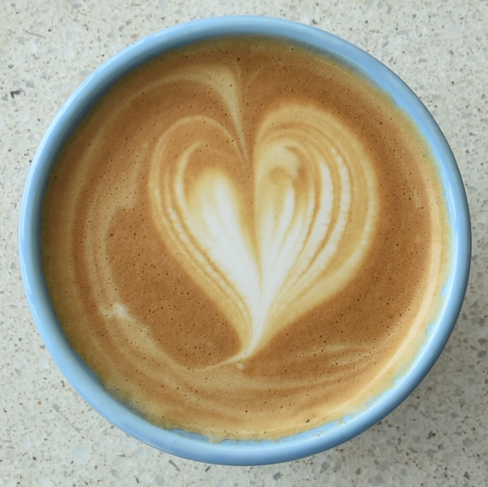 The latte art in my Therma Cup at % Arabica, Arashiyama.