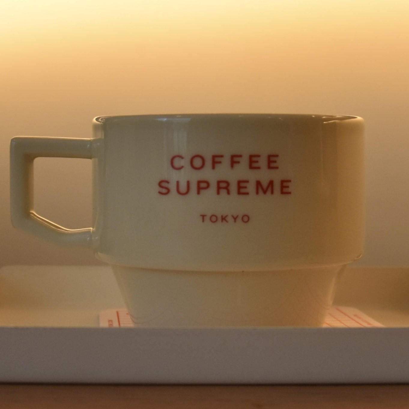 The cup says it all: Coffee Supreme, Tokyo (in bright red capitals on the side)