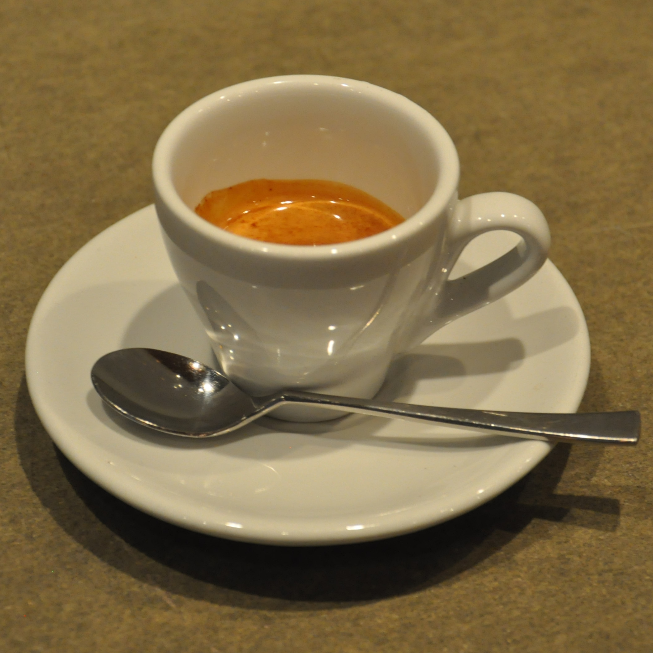 AA lovely single-origin Rwandan espresso, served in a classic white cup in Sentido Speciality Coffee in Kyoto.