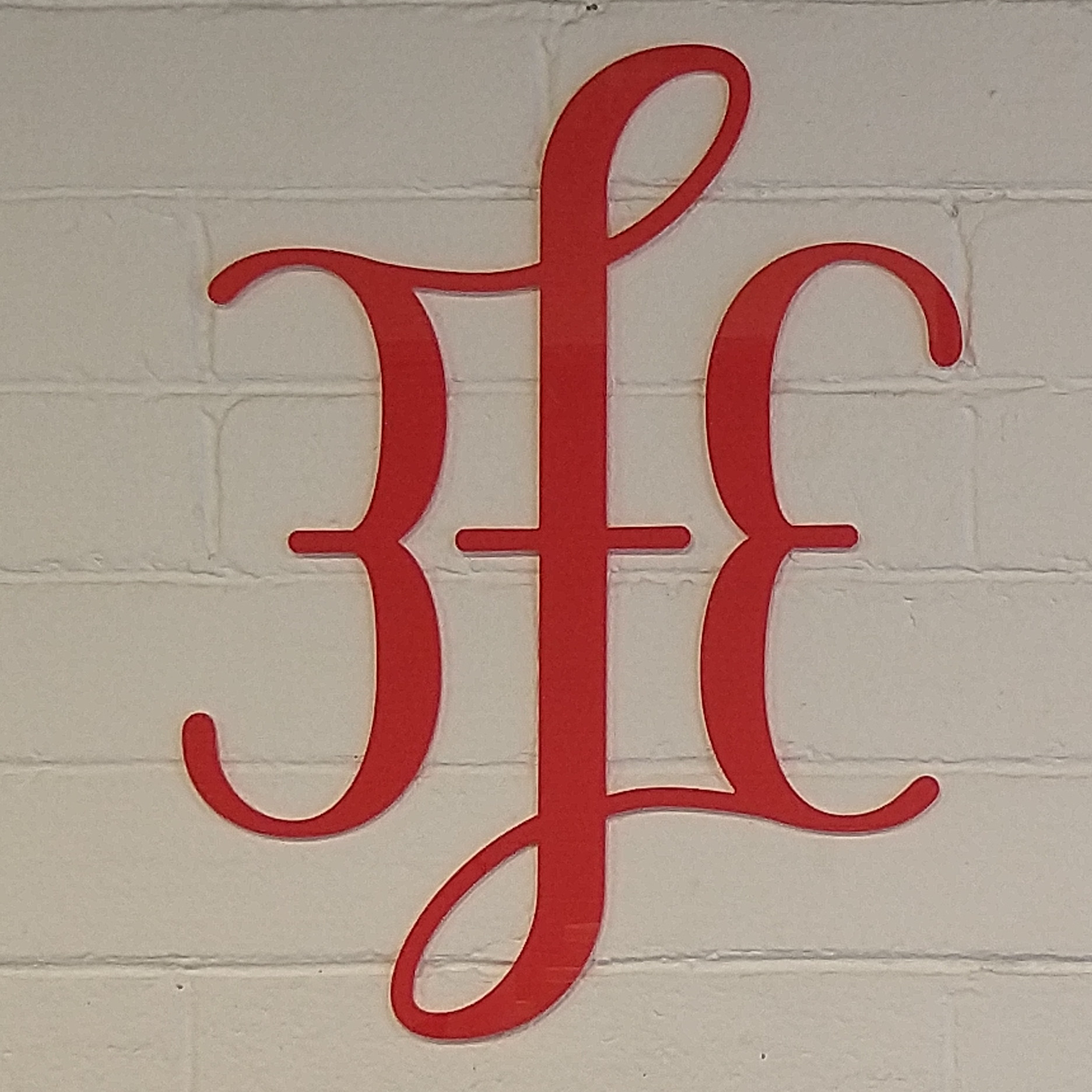 The bright red 3FE logo on the wall behind the counter at 3FE's Sussex Terrace location in Dublin.
