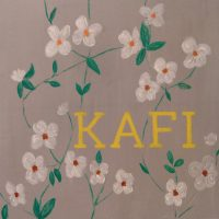 Detail of the wall art in Kafi, Fitzrovia, showing small white flowers on a plain background.