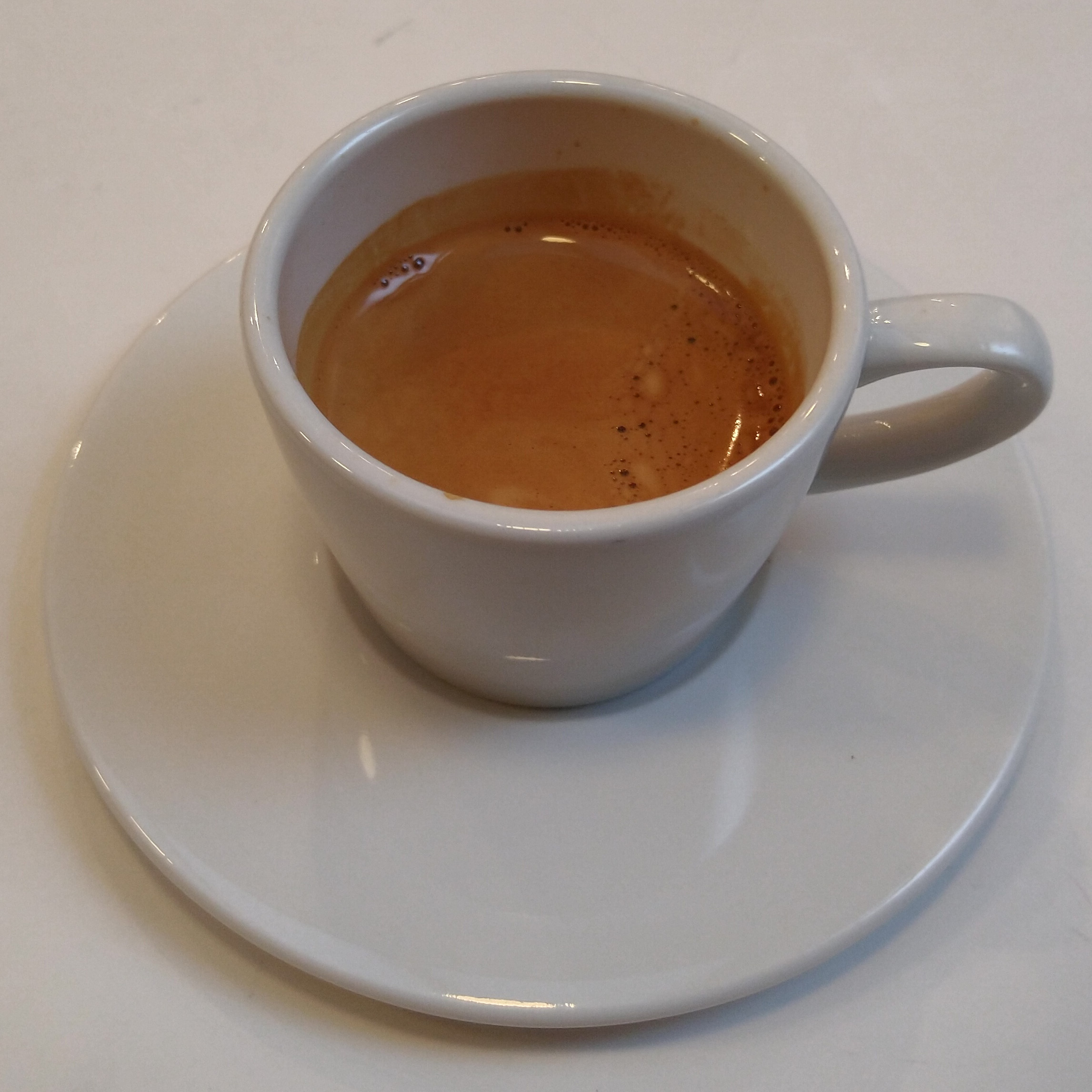 A gorgeous single-origin Ethiopian espresso, roasted in-house, and served in a classic white cup at Kiss the Hippo, Fitzrovia.