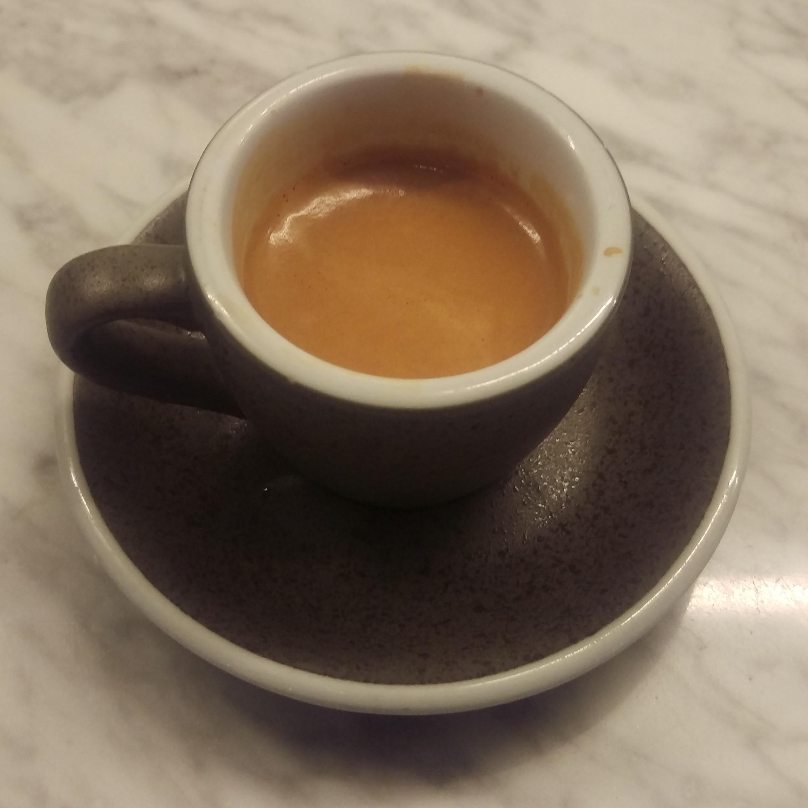 A lovely Brazilian single-origin espresso, served in a classic cup at Press Coffee in Victoria Hall Market, London.