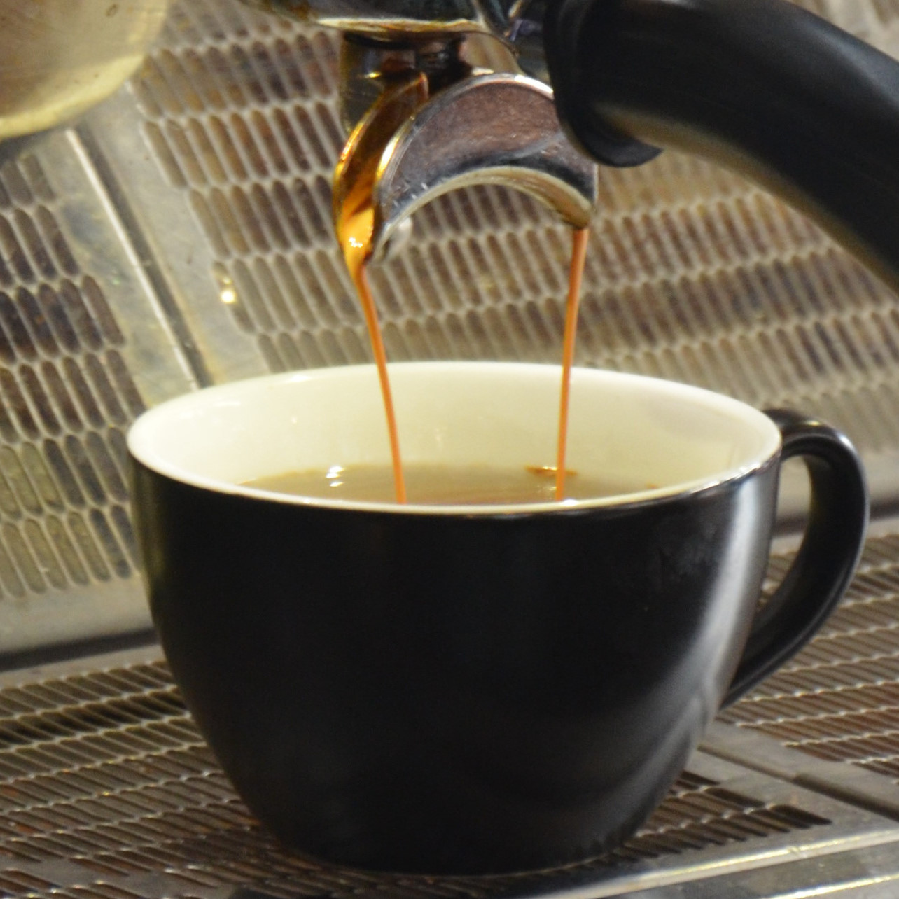 An Americano extracting into a cup of hot water at Three Fools Coffee in Cork