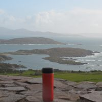My Travel Press, at a stop on the southern part of the Ring of Kerry, overlooking Abbey Island with the Lambs Head headland beyond that, and, in the far distance, the Bere Peninsular.