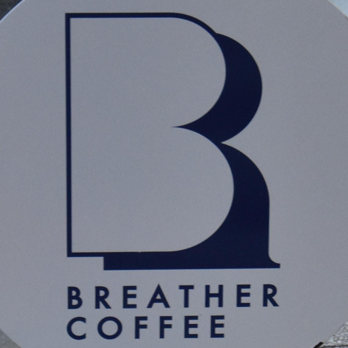 The Breather Coffee logo from the curbside sign outside the shop in Zushi, Kanagawa prefecture, Japan.