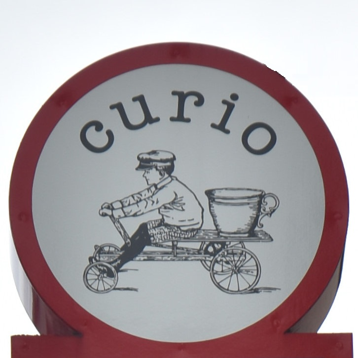 Details of the sign from outside Curio Espresso and Vintage Design in Kanazawa.
