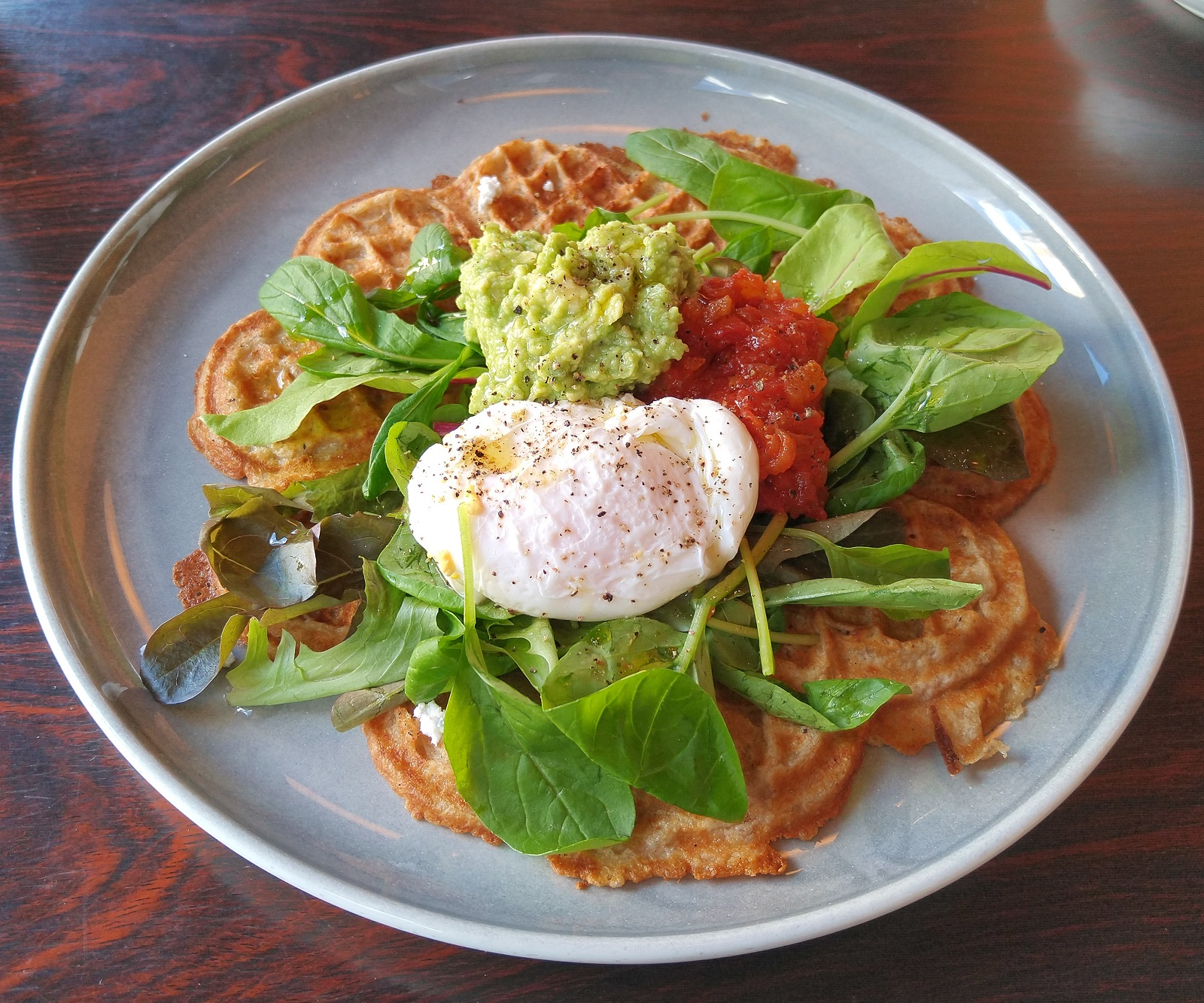 A Norwegian waffle, which I had for breakfast at Fuglen Asakusa, topped with a poached egg, spinach, salsa and avocado.