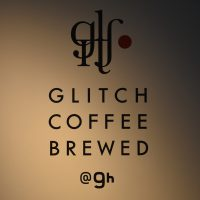 Glitch Coffee Brewed, from the wall behind the counter, with the Glitch Coffee logo above and the Nine Hours hotel logo below.