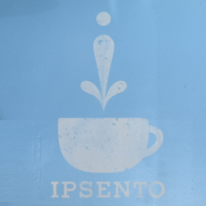 The Ipsento logo from the back wall of the coffee shop's front room on Western Avenue in Chicago.