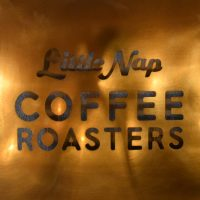 Detail from the sign on the wall: Little Nap Coffee Roasters
