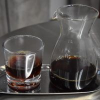 A naturally-processed Yunnan single-origin served in a carafe, with a glass on the side, at UNDEF/NE in Shanghai.