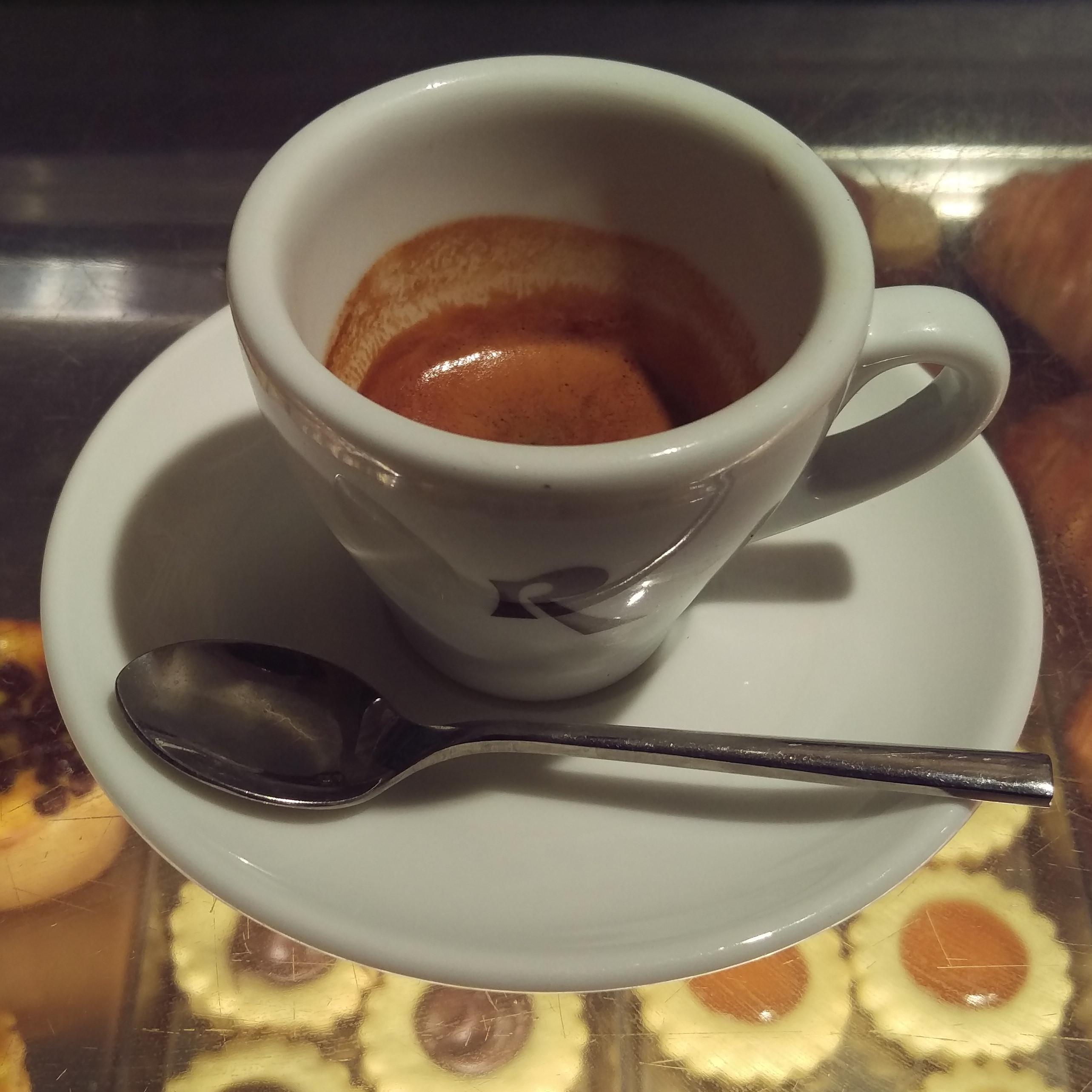 A single espresso in a classic cup at Roscioli Caffè Pasticceria in Rome.