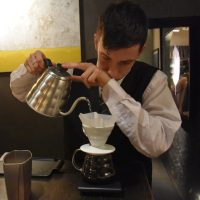 Our barista at Roscioli Caffè Pasticceria, making a V60 at our table.