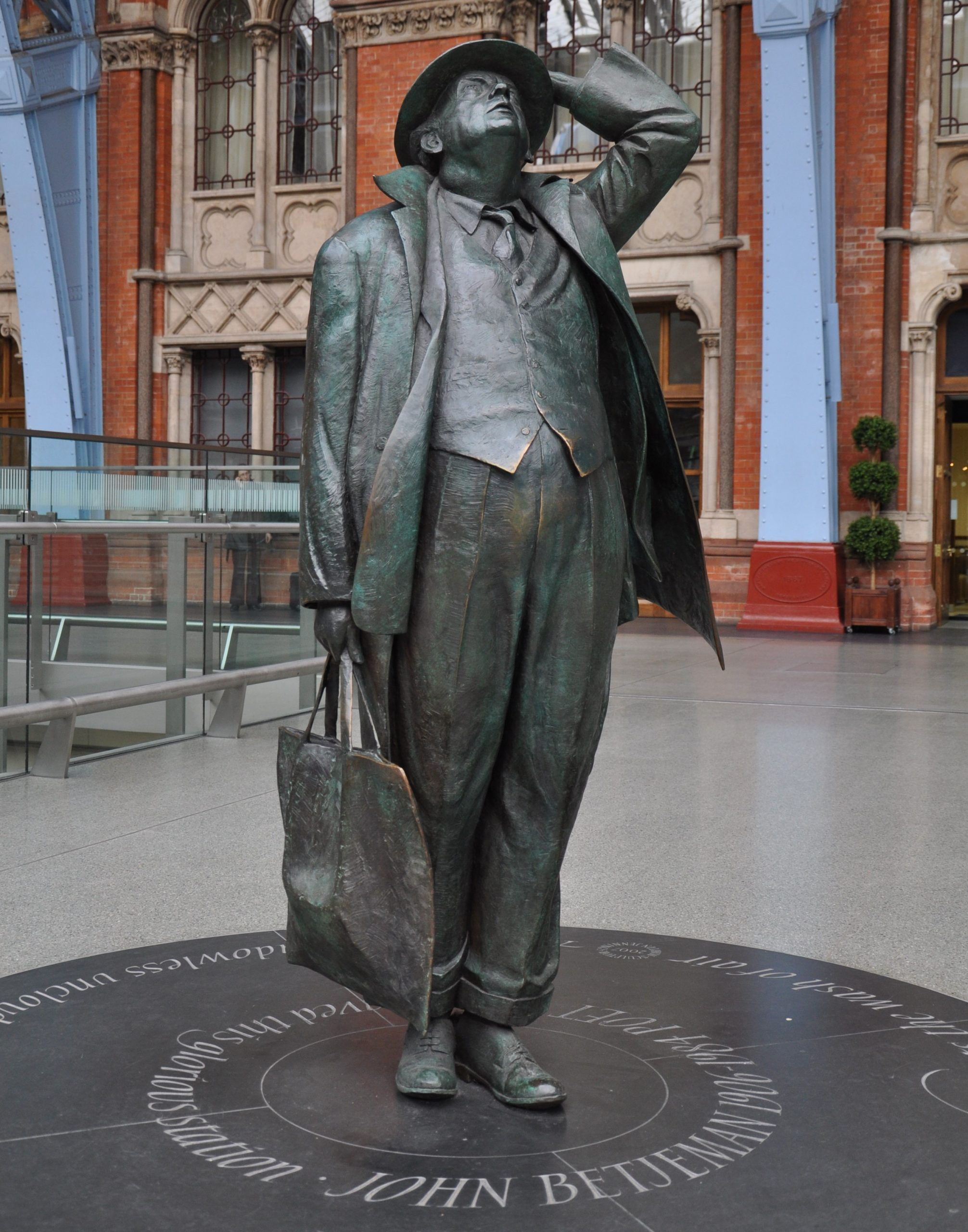 The statue of John Betjeman at St Pancras railway station, by the sculptor Martin Jennings. The statue was designed and cast in bronze in 2007.