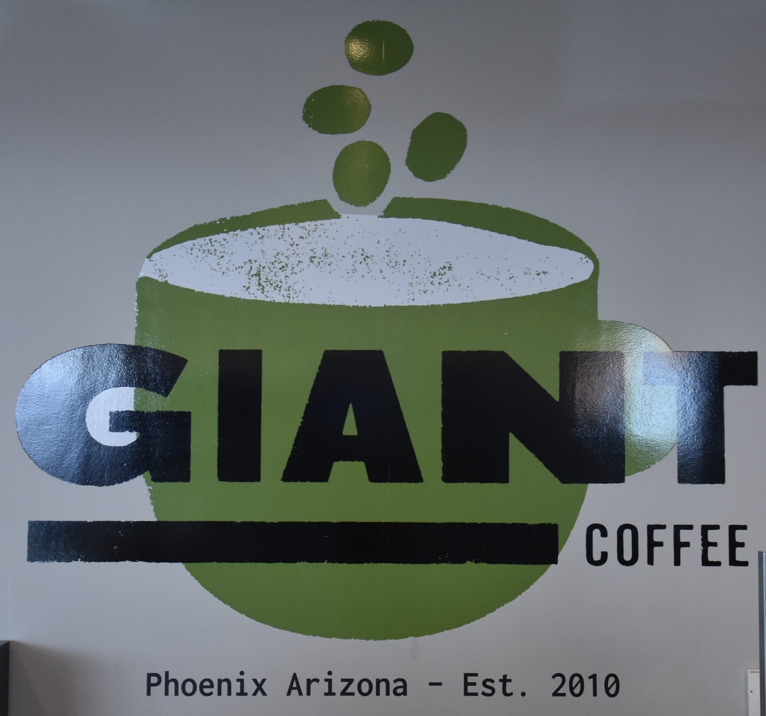 The sign on the wall at Giant Coffee in Terminal 3, Phoenix Sky Harbor.