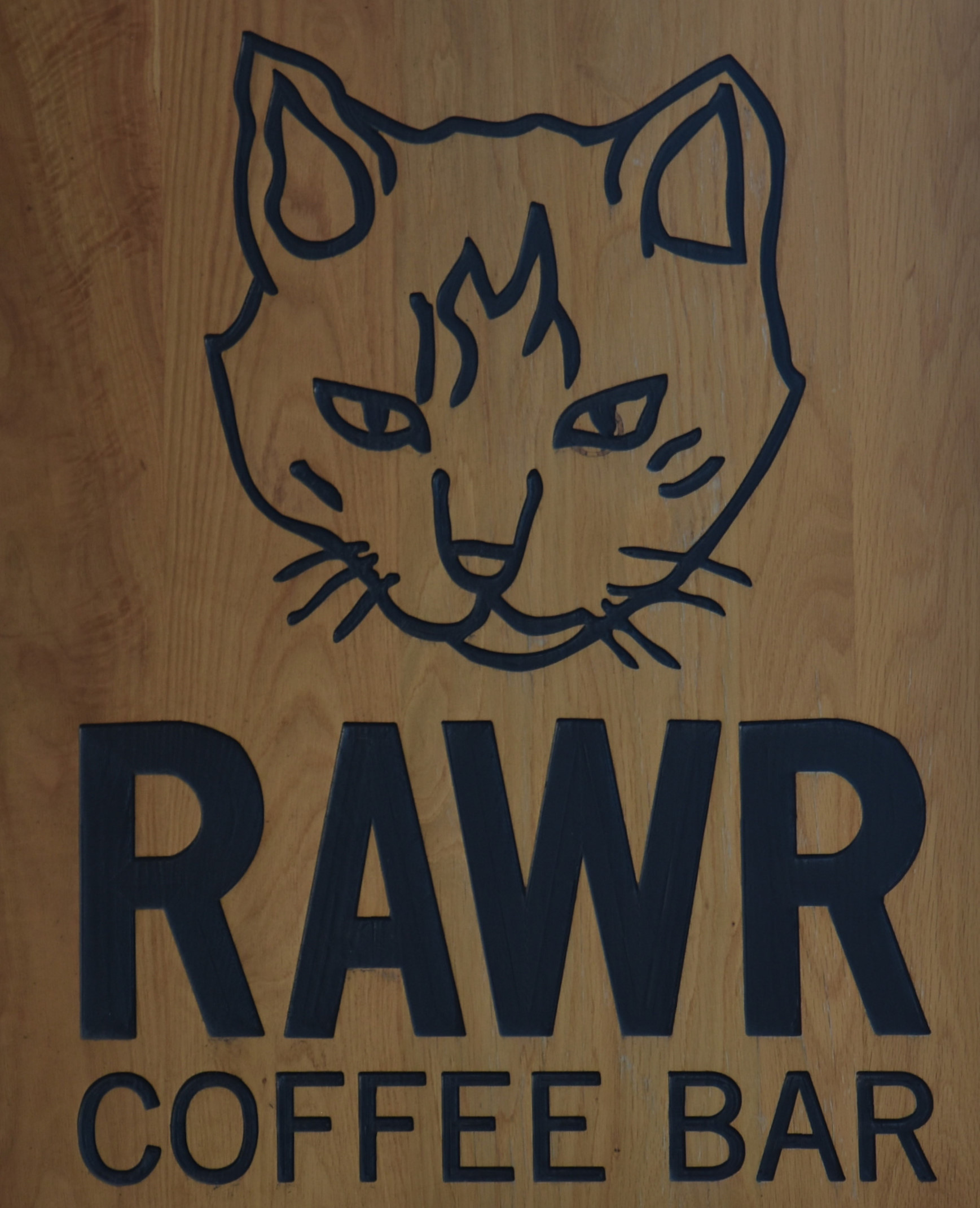 The sign hanging outside RAWR Coffee Bar, part of Cat Town in Oakland, California.