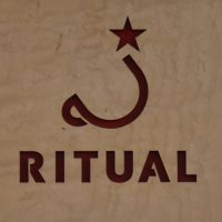 The Ritual Coffee Roasters logo (a stylised cup tilted at 45 degrees with a star balanced on top).