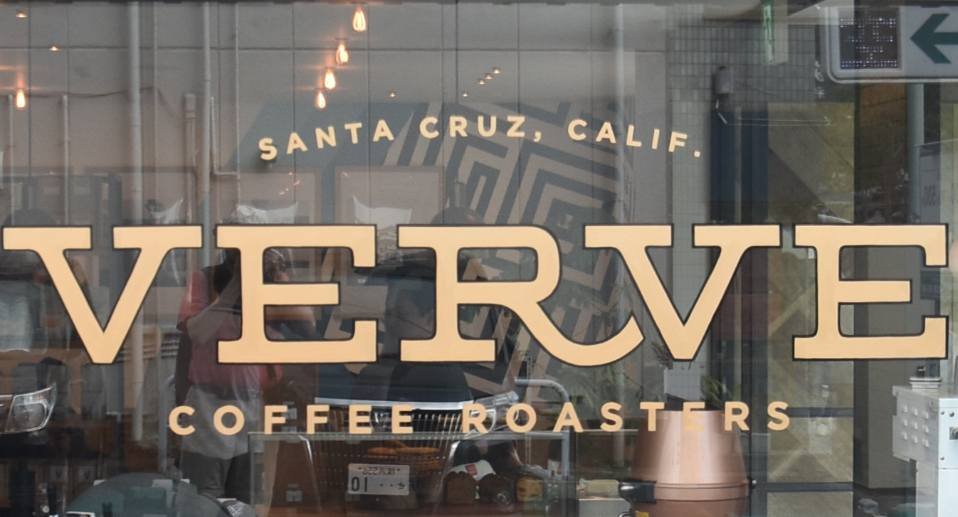 The window at the side of Verve Coffee Roasters in Kamakura Japan, which proudly states Verve's roots in Santa Cruz, California.