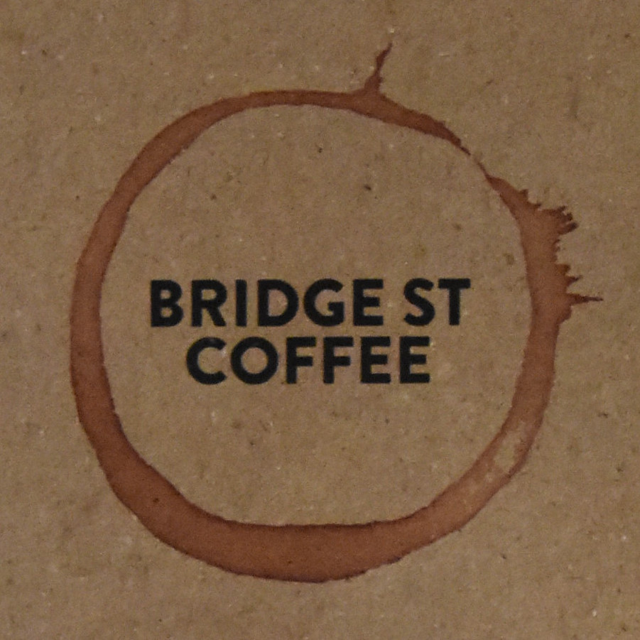 "The Bridge St Coffee logo, taken from the menu, with the words ""Bridge St Coffee"" in capitals inside a coffee stain."