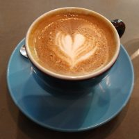 An excellent flat white, made with the Farmhand house-blend, and served in a classic blue cup at Brother Hubbard South.