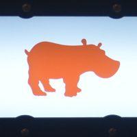 The Kiss the Hippo logo, an orange hippopotamus in silhouette.