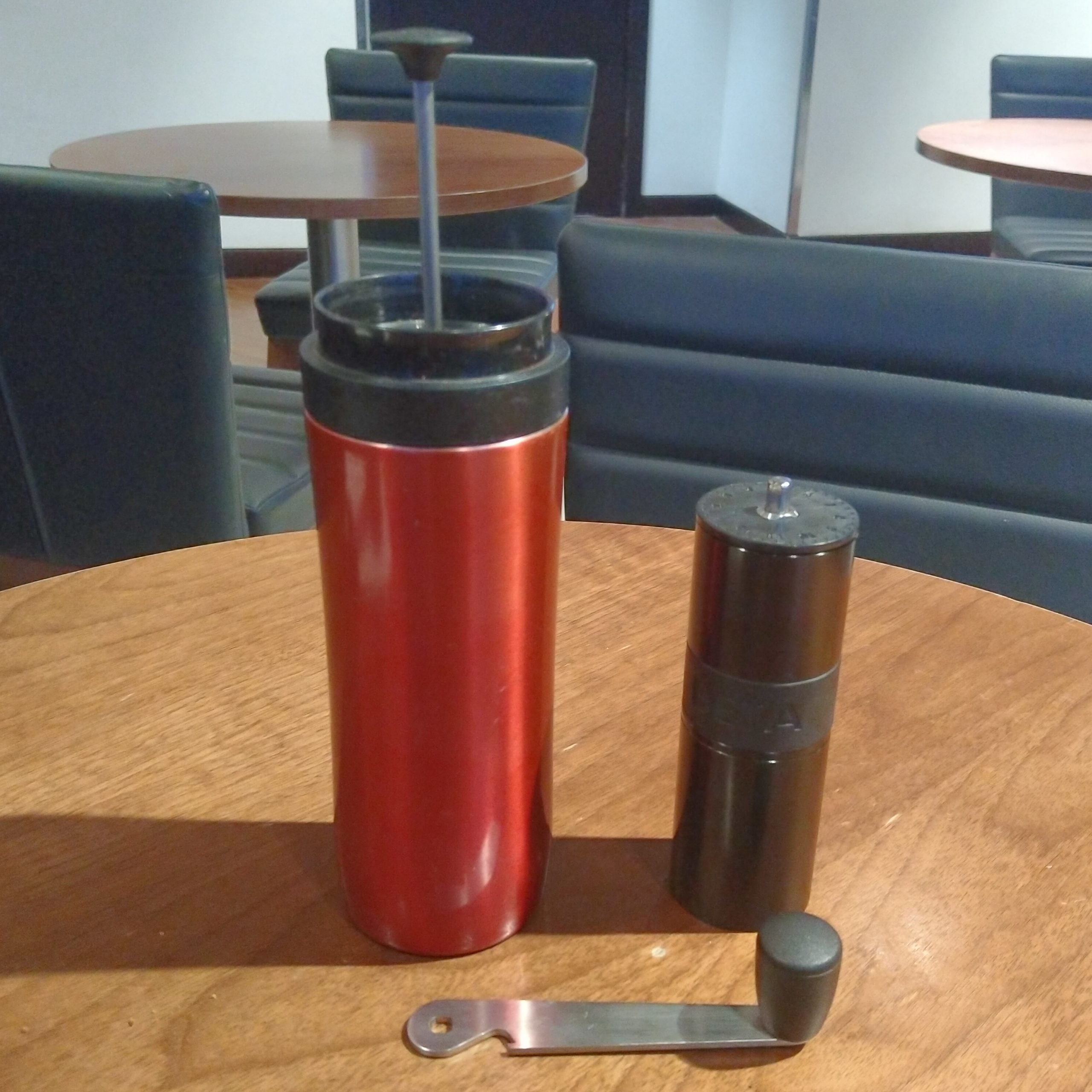 Making my own coffee again, this time in the British Airways lounge at Boston Logan, with my trusty Travel Press and Aergrind.