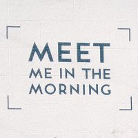 Meet Me in the Morning, written in capitals on the whitewashed upstairs wall next to the window.