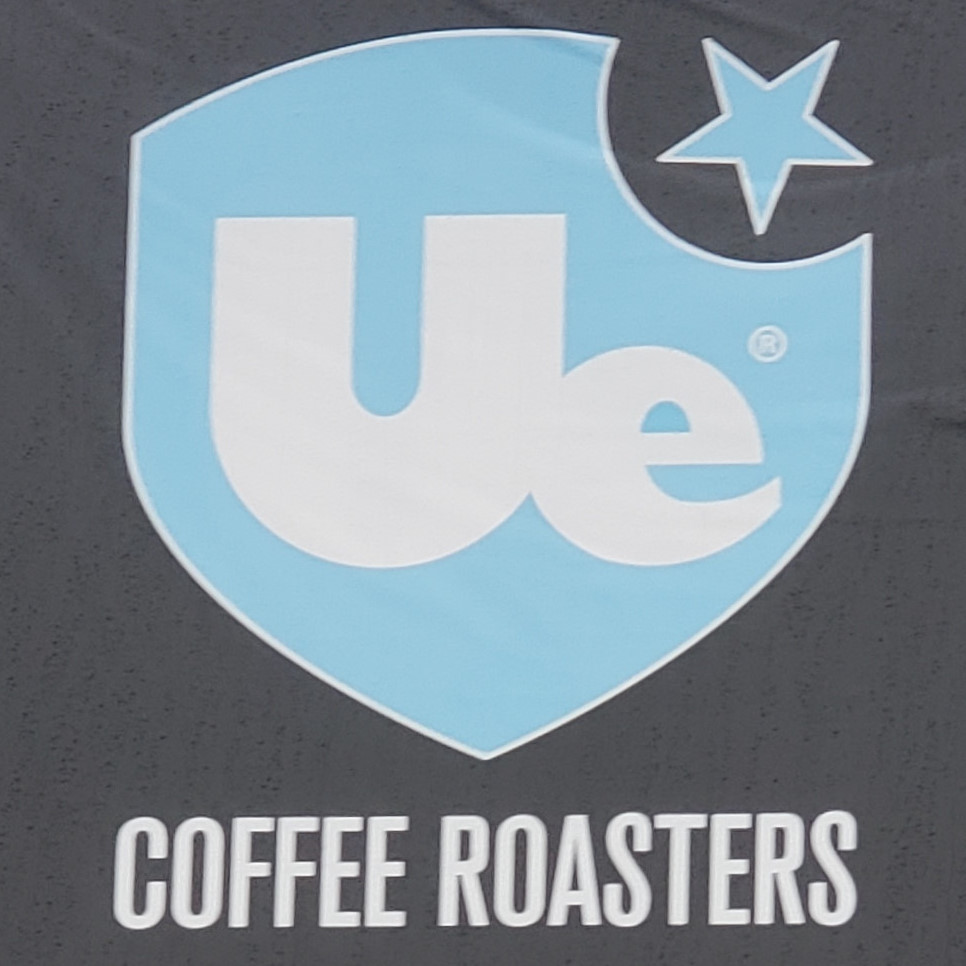 The Ue Coffee Roasters logo from the sign outside the roastery in Witney, Oxfordshire