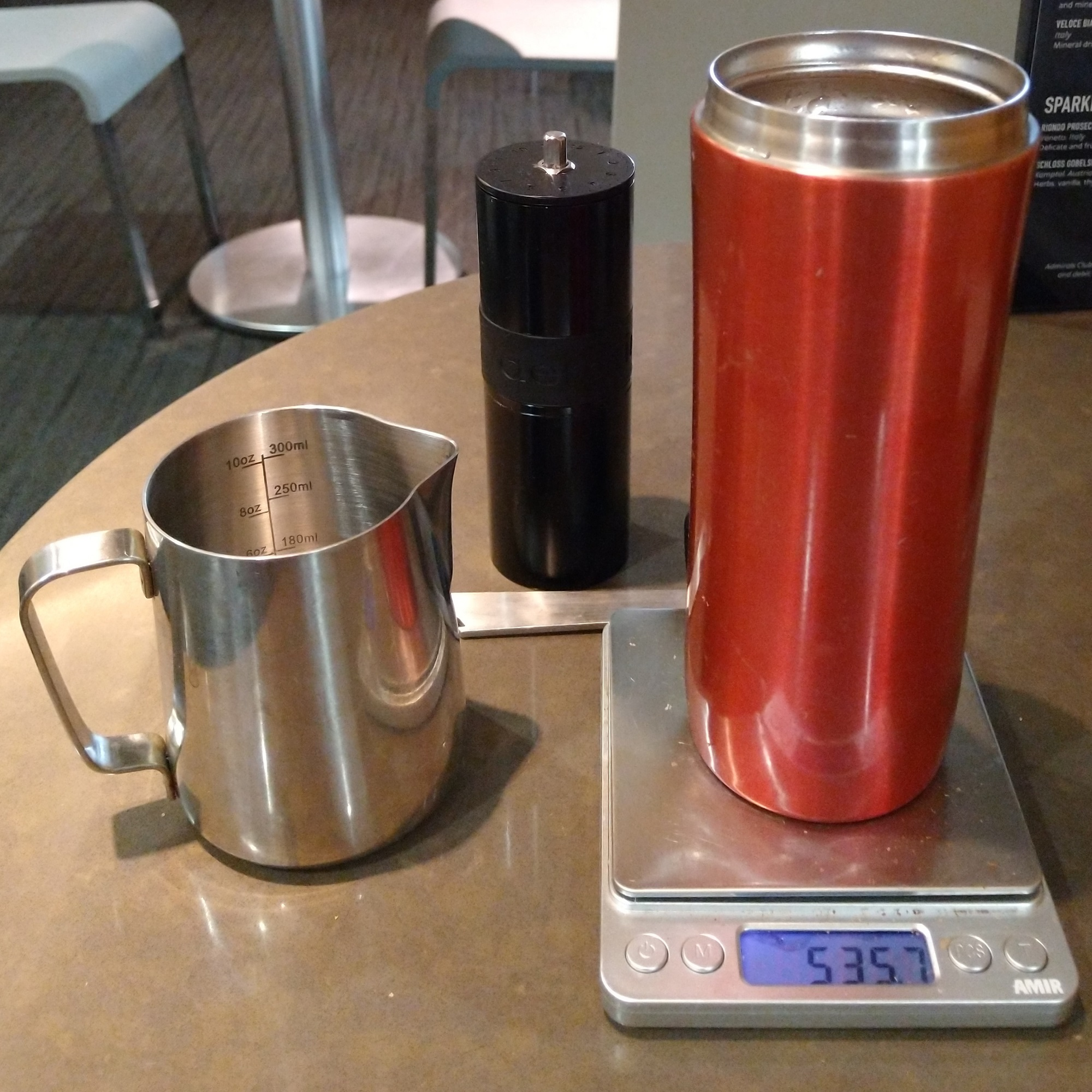 Making my own coffee in the Admirals Club at Atlanta's Hartsfield-Jackson airport. On display are my Travel Press and Aergrind, with beans from Tandem Coffee Roasters and hot water from the lounge's coffee machine.