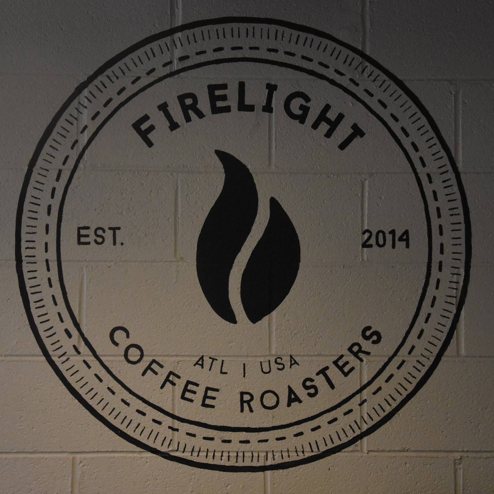 The Firelight Coffee Roasters logo from the back wall of the coffee shop/roastery in Strongbox West, Atlanta.