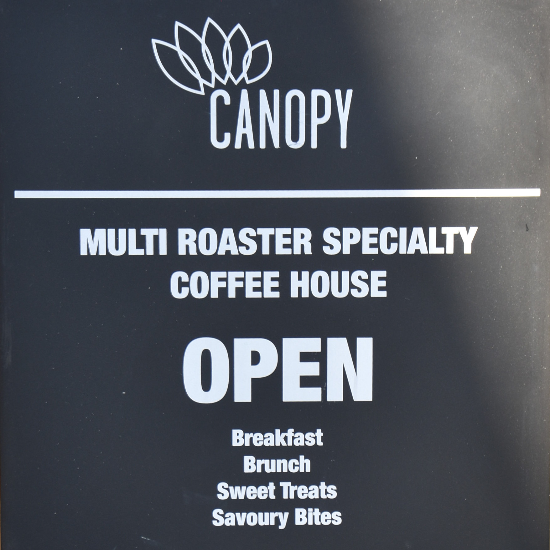 A sight for sore eyes: the A-board proclaiming that Canopy Coffee is now open after almost three months of enforced closure during the COVID-19 pandemic.
