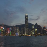 The Hong Kong skyline at dusk, looking across Victoria Harbour from Kowloon towards Central and Two International Finance Centre, the tallest building on the island.