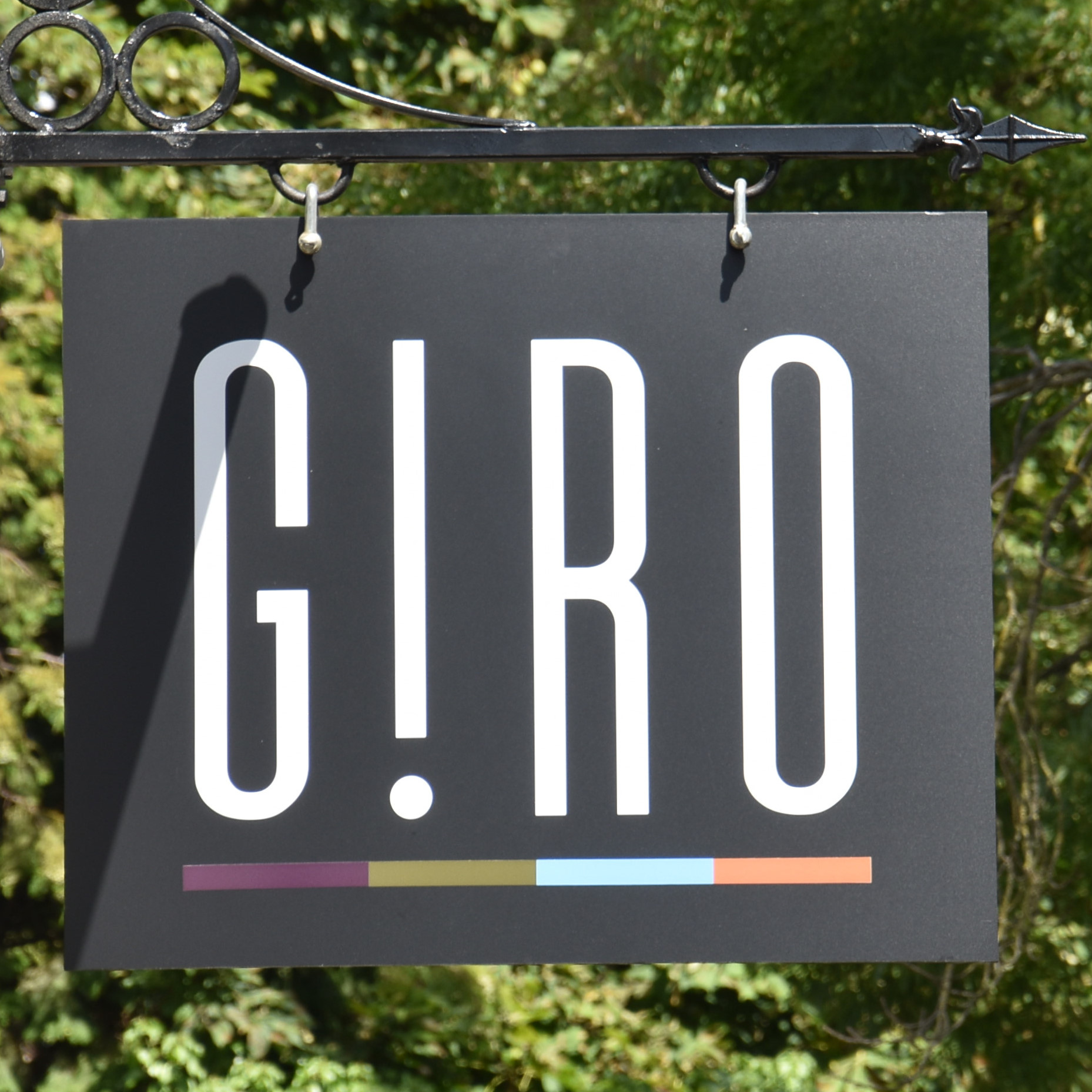 The sign hanging outside G!RO in Esher.
