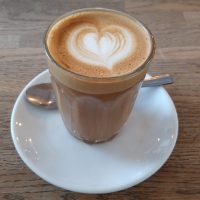 A cortado, served in a glass (a rarity during COVID-19) at Notes, Trafalgar Square.