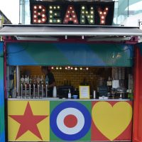 The colourful front of the Beany Green container on the South Bank at the foot of Hungerford Bridge.