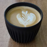 A flat white, made with Ozone's Empire Blend, in my HuskeeCup at Four Corners.