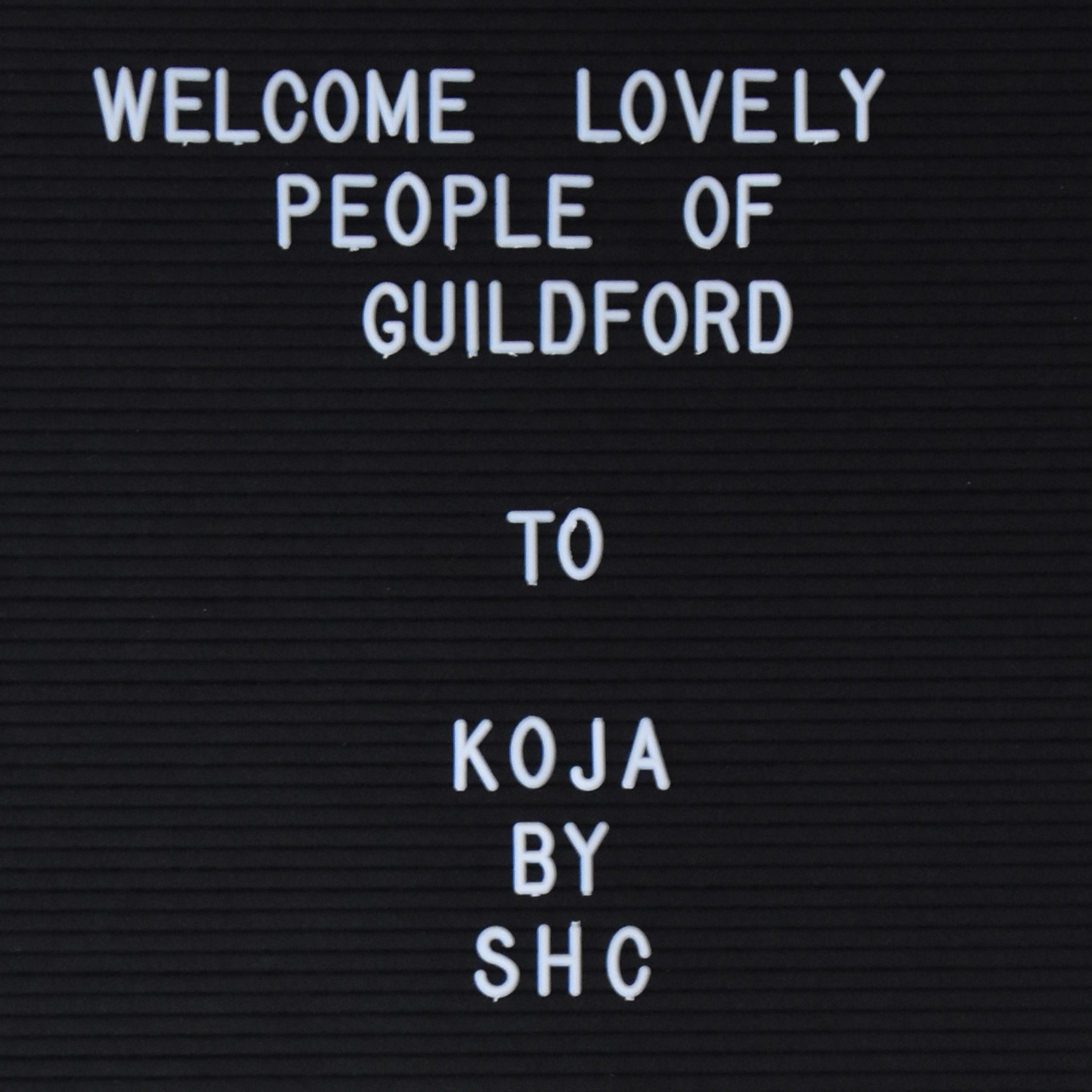 """The sign inside Koja by Surrey Hills Coffee: """"Welcome Lovely People Of Guildford to Koja by SHC"""""""