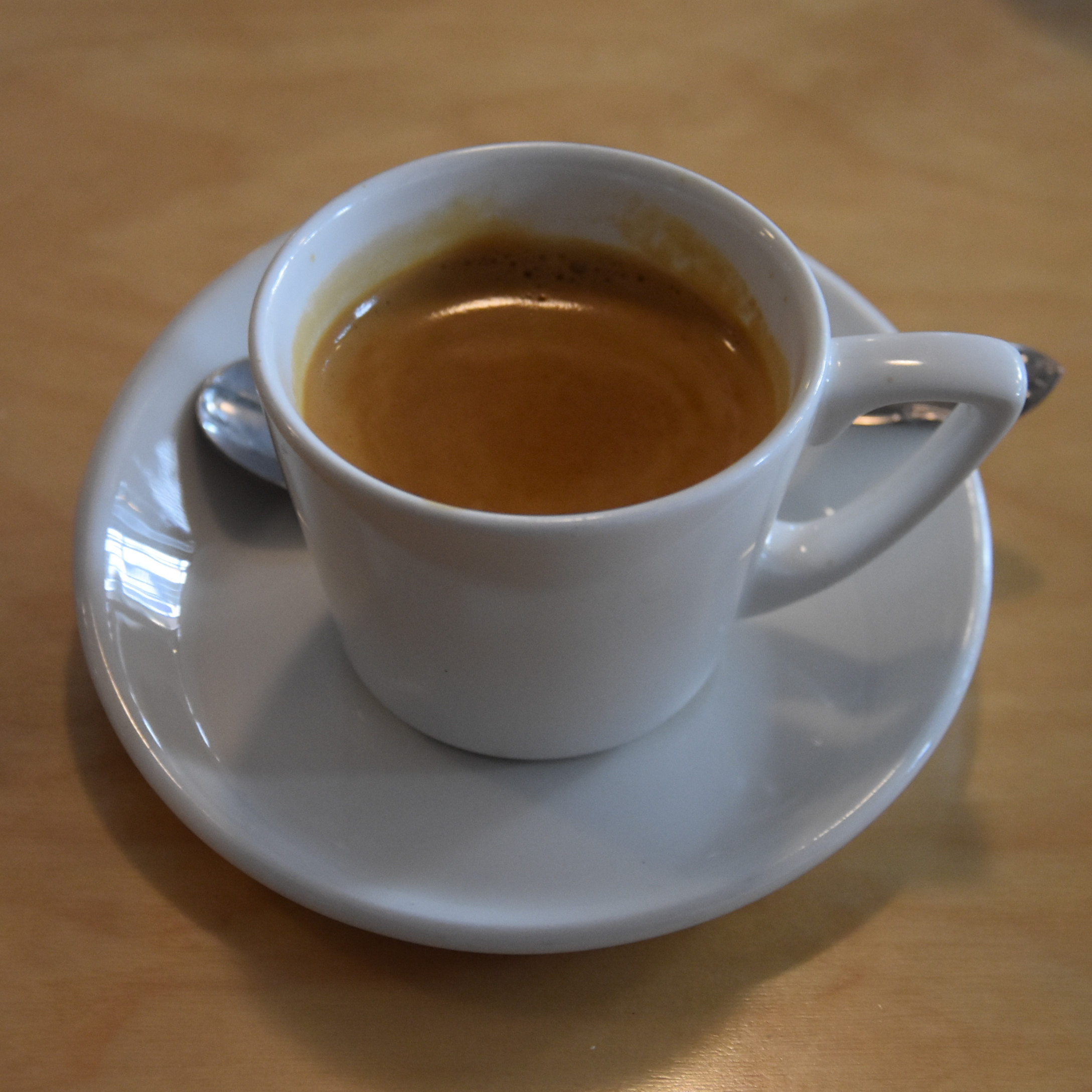 An espresso, made with Panna's bespoke house blend, served in one of its quirky white espresso cups.