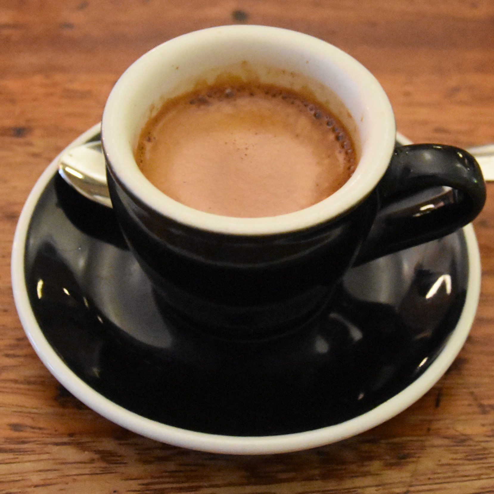 My espresso, made with Square Mile's Red Brick blend, and served in a classic black cup at Kaffeine on Great Titchfield Street.