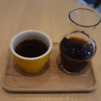 My pour-over at Ngopi in Birmingham, a V60 of a Mount Halu honey-processed coffee, which was roasted in the shop, and served in a carafe, presented on a wooden tray with a handleless cup on the side.